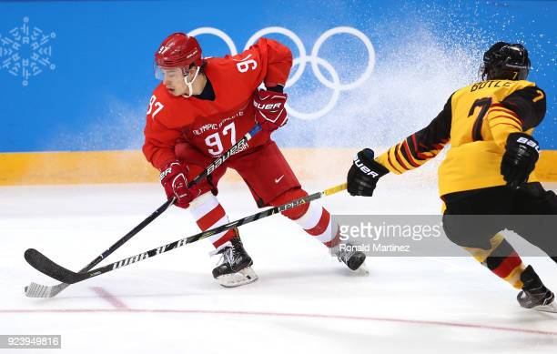 Nikita Gusev of Olympic Athlete from Russia controls the puck against Daryl Boyle of Germany in the first period during the Men's Gold Medal Game on...