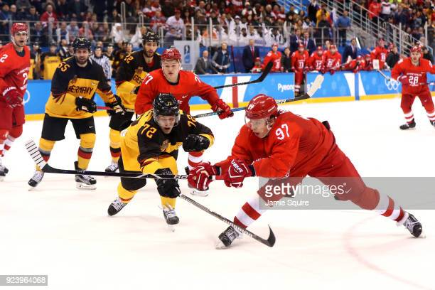 Nikita Gusev of Olympic Athlete from Russia shoots and scores against Dominik Kahun of Germany in the third period during the Men's Gold Medal Game...
