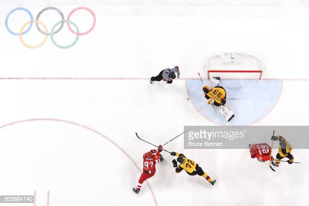 Nikita Gusev of Olympic Athlete from Russia shoots and scores against Dominik Kahun and Danny Aus Den Birken of Germany in the third period during...
