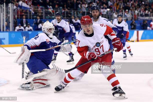 Nikita Gusev of Olympic Athlete from Russia tries to control the puck against goalie Branislav Konrad of Slovakia in the third period during the...