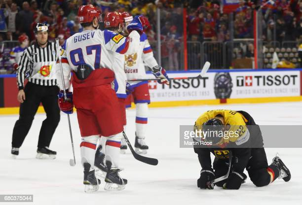 Nikita Gusev of Russia celebrates scoring the fourth goal with teamates as Matthias Plachta of Germany sits dejected on the ice during the 2017 IIHF...