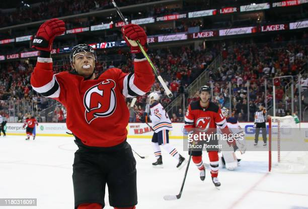 Nikita Gusev of the New Jersey Devils celebrates his goal at 1412 of the second period against the Edmonton Oilers at the Prudential Center on...