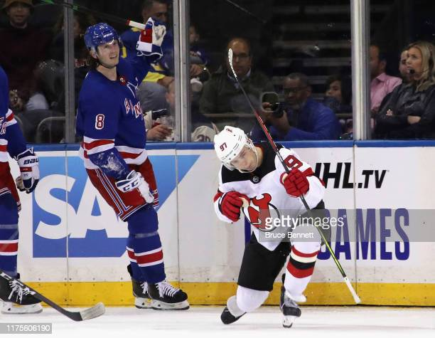 Nikita Gusev of the New Jersey Devils celebrates his second period goal as Jacob Trouba of the New York Rangers skates by at Madison Square Garden on...