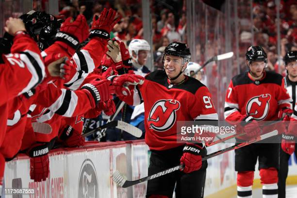 Nikita Gusev of the New Jersey Devils celebrates scoring a goal during the first period against the Winnipeg Jets at the Prudential Center on October...