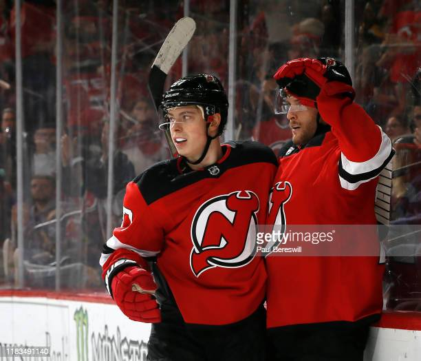 Nikita Gusev of the New Jersey Devils congratulates teammate Blake Coleman after Coleman scored a goal against the Boston Bruins in the second period...