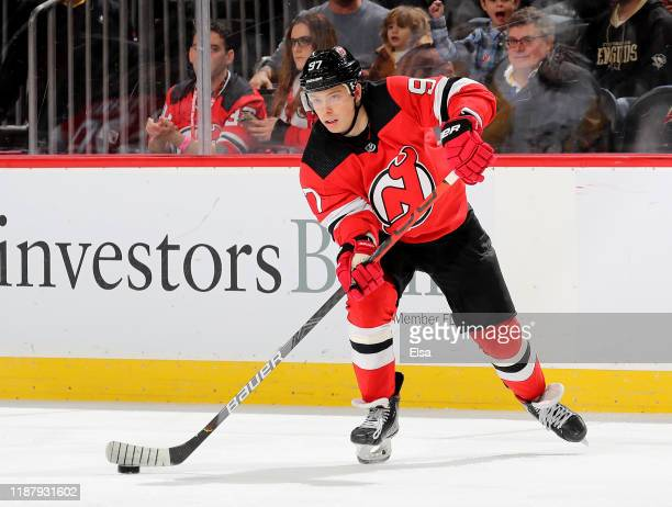 Nikita Gusev of the New Jersey Devils passes the puck in the second period against the Pittsburgh Penguins at Prudential Center on November 15 2019...