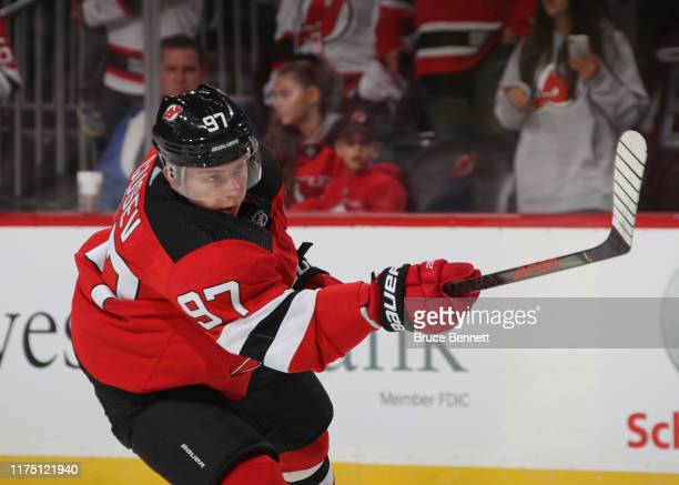 Nikita Gusev of the New Jersey Devils skates in warmups prior to the game against the Boston Bruins during preseason action at the Prudential Center...