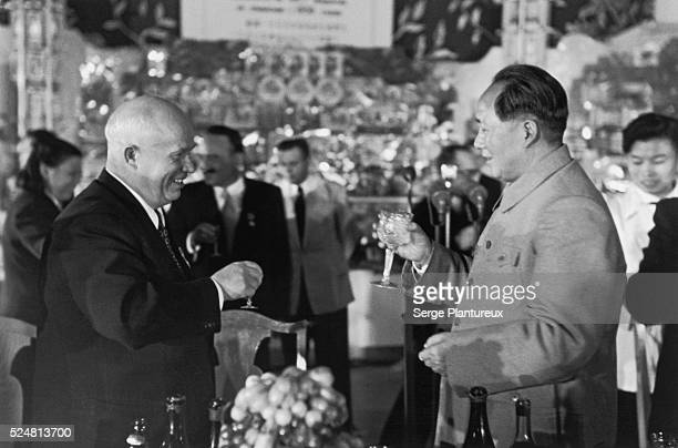 Nikita Khrushchev and Mao Tse Tung toast each other