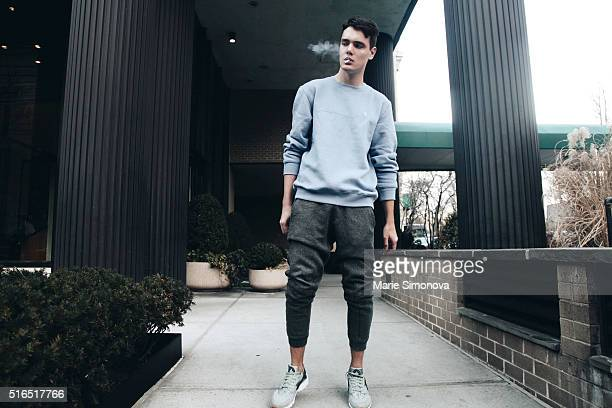 Nikita Kleshch wearing blue Izod sweater grey HM sweatpants and Nike Huarache shoes on March 10 2016 in New York City
