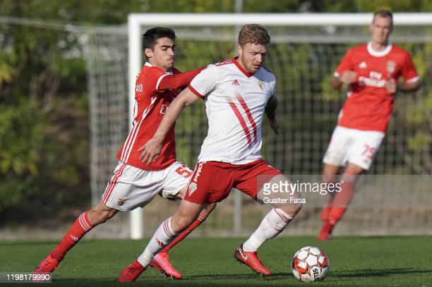 Nikita Korzun of UD Vilafranquense competes for the ball with Rodrigo Conceicao of SL Benfica B in action during the Liga Pro match between SL...
