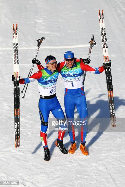 Nikita Kriukov and Alexander Panzhinskiy of Russia celebrate after they crossed the finish line to finish first and second in the Men's Individual...