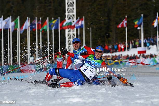 Nikita Kriukov and Alexander Panzhinskiy of Russia celebrate as they fall down after crossing the finish line to finish first and second in the Men's...