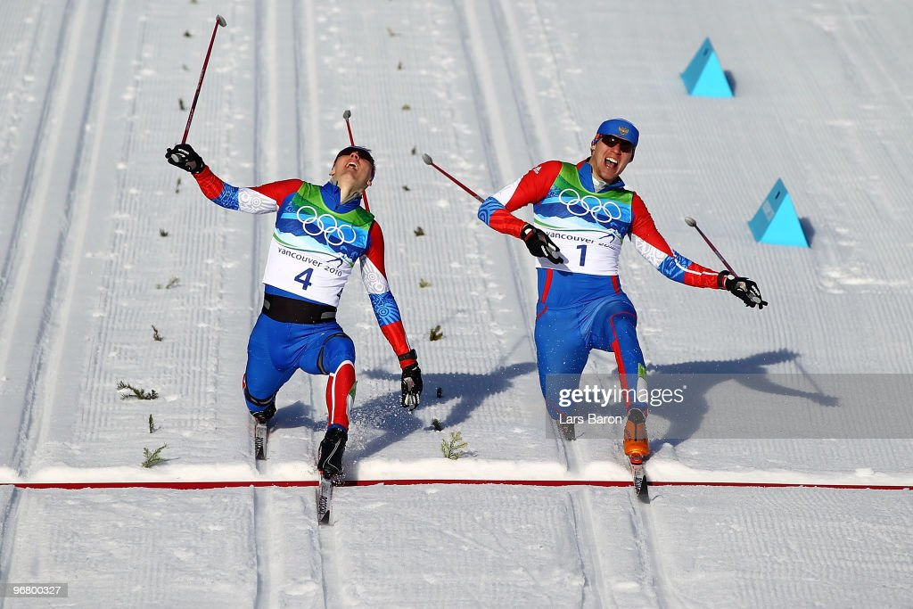 Nikita Kriukov (gold medal winner) and Alexander Panzhinskiy (silver medal winner) of Russia celebrate as they cross the finish line to finish first and second in the Men's Individual Sprint C Final on day 6 of the 2010 Vancouver Winter Olympics at Whistler Olympic Park Biathlon Stadium on February 17, 2010 in Whistler, Canada.