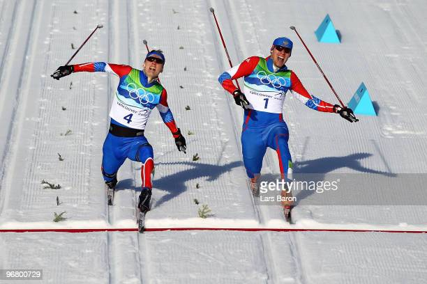 Nikita Kriukov and Alexander Panzhinskiy of Russia cross the finish line to finish first and second in the Men's Individual Sprint C Final on day 6...