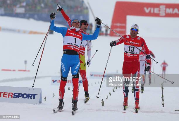 Nikita Kriukov of Russia celebrates victory ahead of Petter jr Northug of Norway and Alex Harvey of Canada in the Men's Cross Country 1.5km Classic...