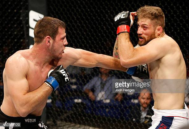 Nikita Krylov lands a left against Cody Donovan in their light heavyweight bout during the UFC Fight Night event at The O2 Dublin on July 19 2014 in...