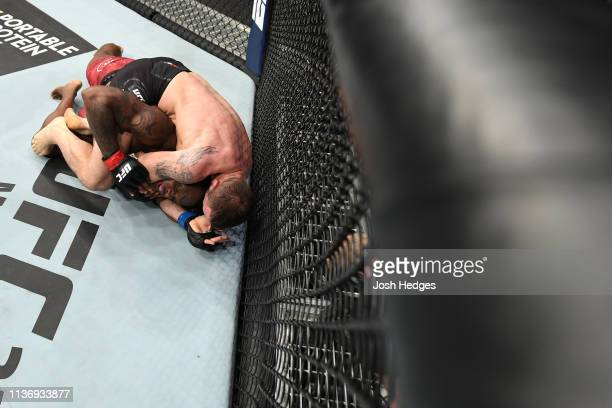 Nikita Krylov of Ukraine attempts to submit Ovince Saint Preux in their light heavyweight bout during the UFC 236 event at State Farm Arena on April...