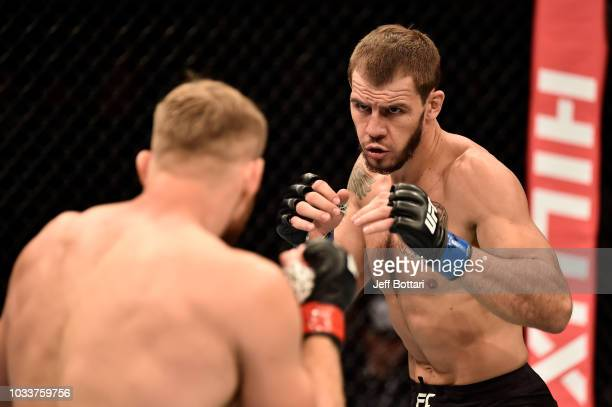 Nikita Krylov of Ukraine battles Jan Blachowicz of Poland in their light heavyweight bout during the UFC Fight Night event at Olimpiysky Arena on...