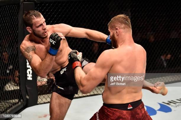 Nikita Krylov of Ukraine kicks Jan Blachowicz of Poland in their light heavyweight bout during the UFC Fight Night event at Olimpiysky Arena on...