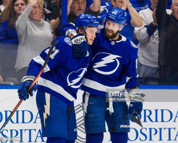 Nikita Kucherov and Brayden Point of the Tampa Bay Lightning celebrate a goal against the New Jersey Devils during the first period at Amalie Arena...
