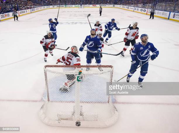 Nikita Kucherov JT Miller and Steven Stamkos of the Tampa Bay Lightning react to a save and deflected puck into the netting by goalie Cory Schneider...