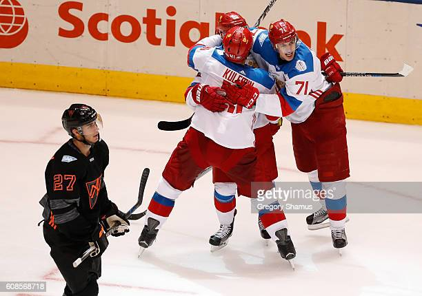 Nikita Kucherov of Team Russia celebrates his second period goal with Evgeni Malkin and Nikolay Kulemin behind Ryan Murray of Team North America...