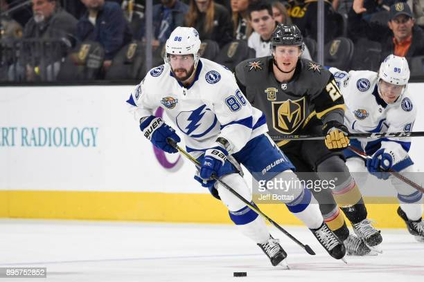 Nikita Kucherov of the Tamp Bay Lightning skates with the puck while Cody Eakin of the Vegas Golden Knights defends during the game at TMobile Arena...
