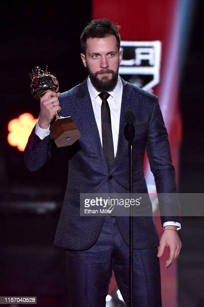 Nikita Kucherov of the Tampa Bay Lightning accepts the Hart Memorial Trophy, awarded to the player adjudged to be the most valuable to his team,...