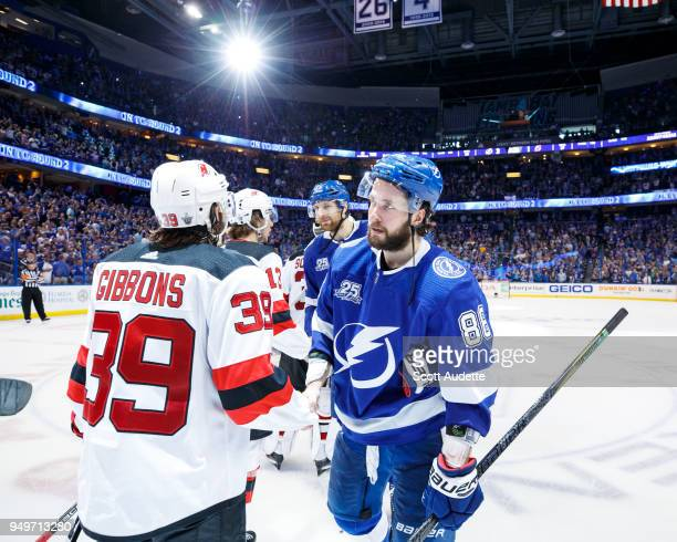 Nikita Kucherov of the Tampa Bay Lightning and Brian Gibbons of the New Jersey Devils shake hands after Game Five of the Eastern Conference First...