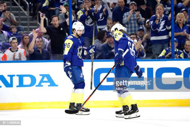R} Nikita Kucherov of the Tampa Bay Lightning and Erik Karlsson of the Ottawa Senators celebrate after a goal in the first half during the 2018 Honda...