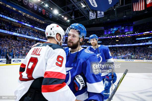 Nikita Kucherov of the Tampa Bay Lightning and Taylor Hall of the New Jersey Devils shake hands after Game Five of the Eastern Conference First Round...