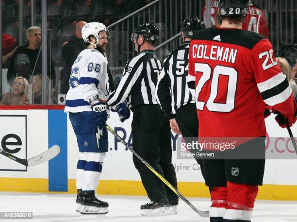 Nikita Kucherov of the Tampa Bay Lightning attempts to get the game winning puck that was picked up by a New Jersey Devils player following the game...