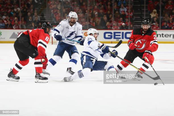 Nikita Kucherov of the Tampa Bay Lightning battles for possession against Blake Coleman of the New Jersey Devils in Game Four of the Eastern...