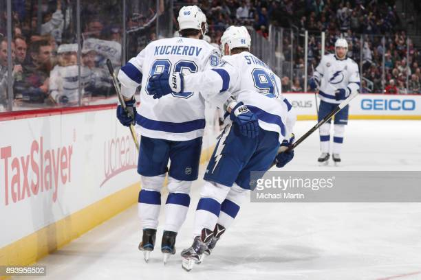 Nikita Kucherov of the Tampa Bay Lightning celebrates a goal against the Colorado Avalanche with teammate Steve Stamkos at the Pepsi Center on...