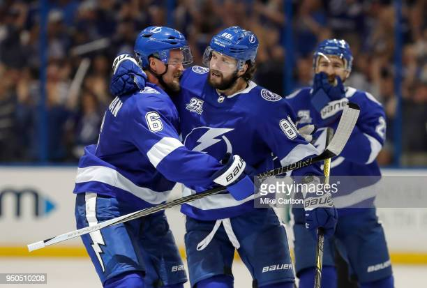 Nikita Kucherov of the Tampa Bay Lightning celebrates a goal against the New Jersey Devils with teammate Anton Stralman in the third period of Game...