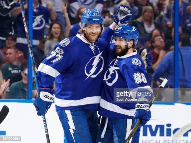 Nikita Kucherov of the Tampa Bay Lightning celebrates a goal with teammate Victor Hedman against the Minnesota Wild during the first period at Amalie...