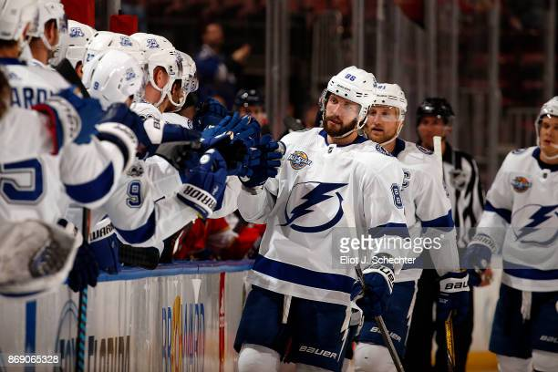 Nikita Kucherov of the Tampa Bay Lightning celebrates a goal with teammates against the Florida Panthers at the BBT Center on October 30 2017 in...
