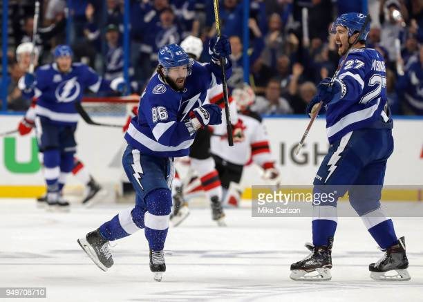 Nikita Kucherov of the Tampa Bay Lightning celebrates a goal with Ryan McDonagh against the New Jersey Devils in the third period of Game Five of the...