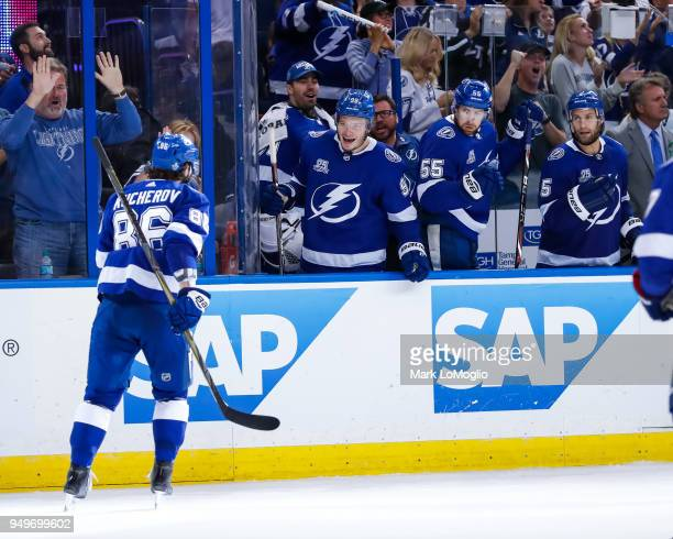 Nikita Kucherov of the Tampa Bay Lightning celebrates his game winning and series clinching goal with teammates against the New Jersey Devils in Game...