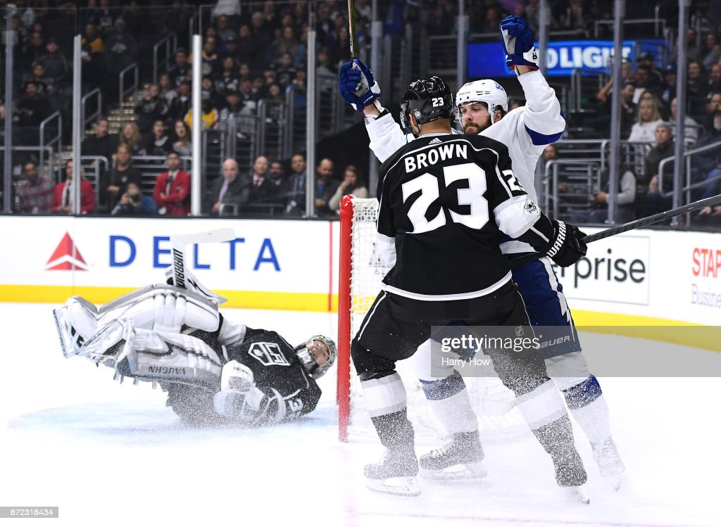 Nikita Kucherov #86 of the Tampa Bay Lightning celebrates his goal in front of Dustin Brown #23 and Jonathan Quick #32 of the Los Angeles Kings to take a 1-0 lead during the first period at Staples Center on November 9, 2017 in Los Angeles, California.