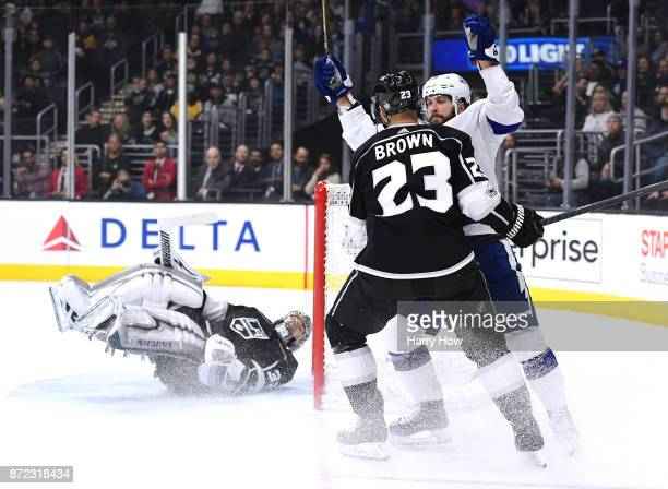 Nikita Kucherov of the Tampa Bay Lightning celebrates his goal in front of Dustin Brown and Jonathan Quick of the Los Angeles Kings to take a 10 lead...