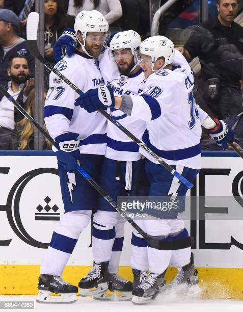 Nikita Kucherov of the Tampa Bay Lightning celebrates his goal against the Toronto Maple Leafs with teammates Victor Hedman and Ondrej Palat during...
