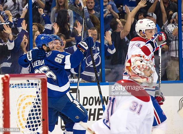 Nikita Kucherov of the Tampa Bay Lightning celebrates his goal with teammate Ondrej Palat against goalie Carey Price and Alexei Emelin of the...