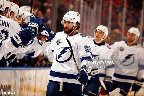 Nikita Kucherov of the Tampa Bay Lightning celebrates his goal with teammates against the Florida Panthers during the first period on opening night...