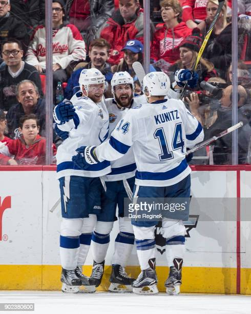 Nikita Kucherov of the Tampa Bay Lightning celebrates his third period goal with teammates Steven Stamkos and Chris Kunitz during an NHL game against...