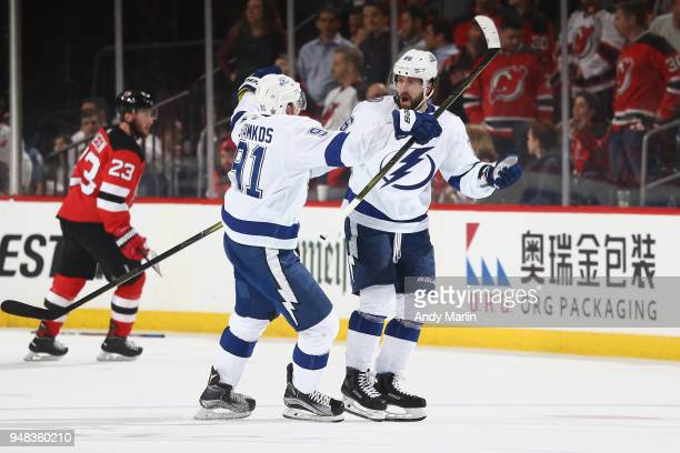 Nikita Kucherov of the Tampa Bay Lightning celebrates his third period empty net goal with Steven Stamkos in Game Four of the Eastern Conference...