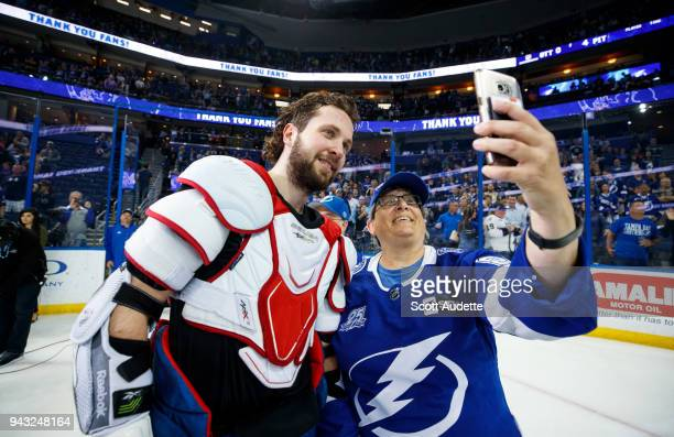Nikita Kucherov of the Tampa Bay Lightning celebrates the win against the Buffalo Sabres and gives away his gameworn jersey to a fan at Amalie Arena...