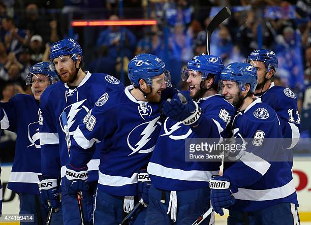 Nikita Kucherov of the Tampa Bay Lightning celebrates with his teammates after scoring the game winning goal in overtime to defeat the New York...