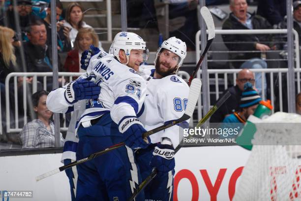 Nikita Kucherov of the Tampa Bay Lightning celebrates with teammate Steven Stamkos after scoring a goal against the San Jose Sharks at SAP Center on...