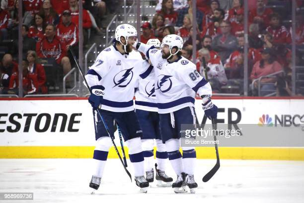 Nikita Kucherov of the Tampa Bay Lightning celebrates with teammate Victor Hedman after scoring a goal against Braden Holtby of the Washington...